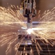 Stock Photo: Plasmcutting process of metal with sparks
