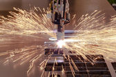 Plasma cutting process of metal with sparks — Stock Photo