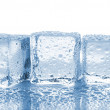 Three melted ice cubes — Stock Photo #31154363