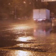 Stock Video: Cars go at night in rain time lapse