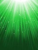 Snow and stars on green luminous rays. — Stock Vector