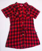 Shirt, kids dress & shirt on background. — Стоковое фото