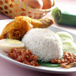 Nasi lemak traditional spicy rice dish — Stock Photo