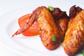 Chicken wings with background — Stock Photo