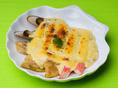 Seafood baked with cheese, seafood gratin — Stockfoto