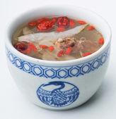 Chicken and herb soup in pot, Chinese food style. — Stock Photo