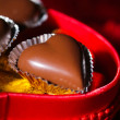 Chocolates heart-shaped, on background — Stock Photo