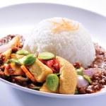 Nasi lemak traditional malaysian spicy rice dish — Stock Photo #35072461