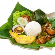 Indonesian traditional food, chicken, fish and vegetables — Stock Photo