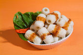 Asian dishes - variety of raw fish meat for steamboat — Stock Photo