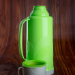 Thermo, Plastic Thermo flask on background. — Stock Photo