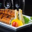 Stock Photo: Japanese cuisine. unagi or eel on background
