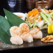 Stock Photo: Japanese cuisine. grilled shell fish on background