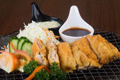 Japanese cuisine. fried chicken on the background — Stock Photo