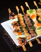 Japanese cuisine. grill stick on the background — Stock Photo