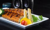 Japanese cuisine. unagi or eel on the background — Stock Photo