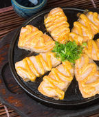Japanese cuisine. hot plate fish on the background — Stock Photo