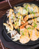 Japanese cuisine. hot plate sea food on the background — Stock Photo