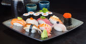 Japanese cuisine. sushi set on the background — Stock fotografie