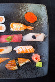 Japanese cuisine. sushi set on the background — Stock Photo