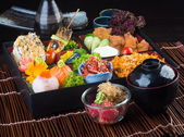 Japanese cuisine. lunch box set on the background — Stock Photo