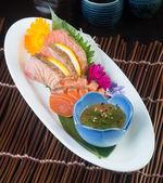 Japanese cuisine. sashimi on the background — Stock Photo