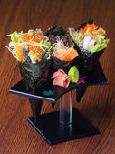 Japanese cuisine. hand roll on the background — Stock Photo