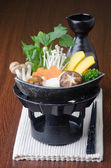 Japanese cuisine. hot pot on the background — Stock Photo