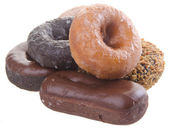 Donuts. delicious and sweet donuts on background — Stock Photo