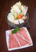 Japanese cuisine. hot pot on the background — Stock Photo