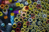 Many colorful spools of thread for sewing background — Stockfoto