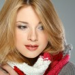 A photo of beautiful girl is in winter clothes — Stock Photo #13321573