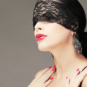 Portrait elegant sexual brunette woman is in a black lace mask — Stock Photo
