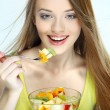 Portrait of a pretty young woman with fruit isolated on a white background — Stock Photo