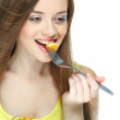 Portrait of a pretty young woman eating fruit salad — Stock Photo #13896080