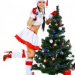 Beautiful and sexy woman wearing santa clause costume isolated o — Stock Photo #17130983