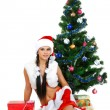 Beautiful and sexy woman wearing santa clause costume isolated o — Stockfoto