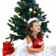Little beautiful girl near a christmas tree isolated on a white background — Stock Photo #17131233