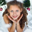 Little beautiful girl near a christmas tree isolated on a white background — Stock Photo #17131249