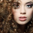 Young beautiful woman with long curly hairs — Stock Photo #18973635