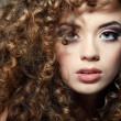 Young beautiful womwith long curly hairs — Stock Photo #18973637