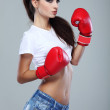 Beautiful sexual boxing girl, fitness, on a grey background — Stock Photo #18983345