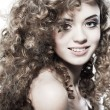 Young beautiful woman with long curly hairs - Foto de Stock