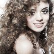 Stock Photo: Young beautiful womwith long curly hairs
