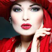 Beautiful girl in the red fabric — Stock Photo