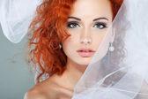 Portrait of beautiful redheaded bride. Wedding dress. Wedding decoration — Stock Photo