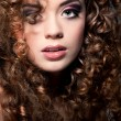 Young beautiful woman with long curly hairs — Stock Photo