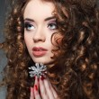 Young beautiful womwith long curly hairs — Stock Photo #23628619