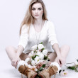 A photo of beautiful girl is in fashion style with the basket of flowers ,vintag — Stock Photo