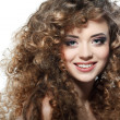 Young beautiful woman with long curly hairs on a white background — Стоковая фотография